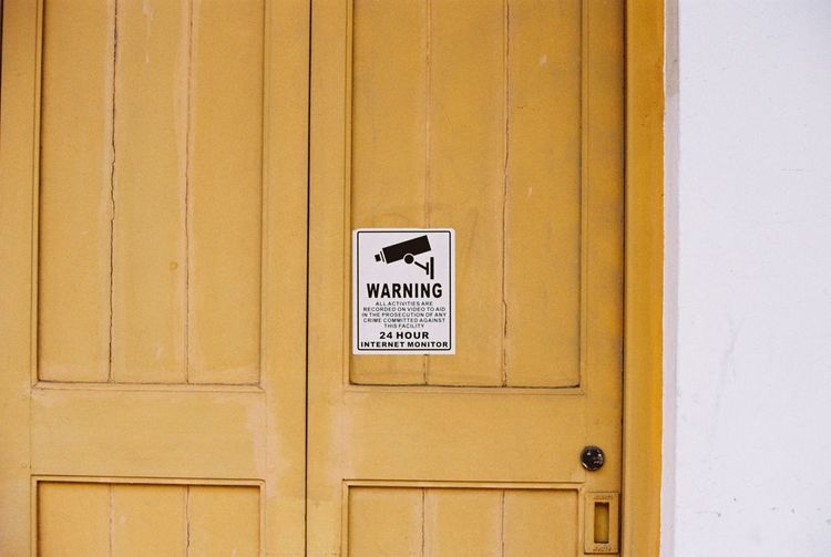 Warning: Big Brother is watching you. Big Brother Big Brother Is Watching You Communication Monitored  Safety Security Security Camera Sign Surveillance Camera Warning Sign Watch Yellow Yellow Door