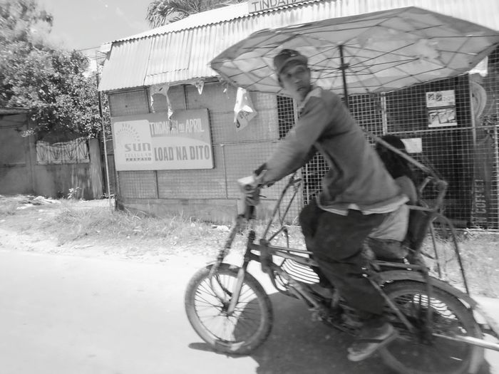 Daily work. . CYCLIST Transportation Bicycle Leisure Activity Mode Of Transport Lifestyles Outdoors City Life Day City Land Vehicle Week Of Eyeem Eyeem Philippines Enjoying Life Xperia X Mobile Photography XPERIA Non-urban Scene Moment Xperiaphotography Eyeemphoto Bnw_friday_eyeemchallenge Bnw Photography Bnw Work Daily Routine