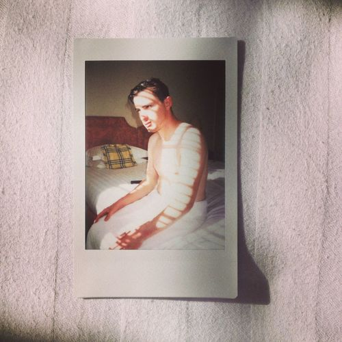 A portrait of my friend using my Polaroid camera, on the Night of his Mothers Wedding