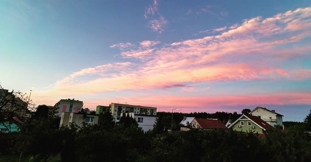 Panoramic view of townscape against sky during sunset