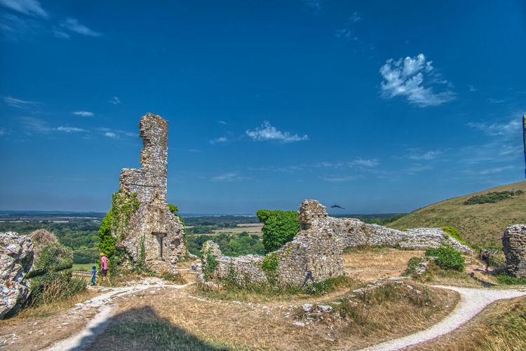 Panoramic view of old ruins against blue sky