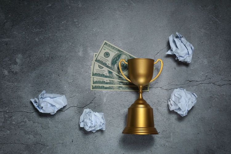 Champion Hopelessness Dollar Bill Paper No People Crumpled Paper Crumpled High Angle View Still Life Indoors  Gray Currency Studio Shot Business Close-up Gray Background Finance Group Of Objects Paper Currency Success Achievement Wealth Creativity Crumpled Paper Ball Concrete