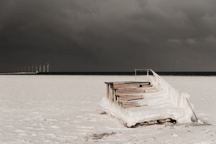 Stepping up for the future, with windmills in the background Winter Denmark Scandinavia Ice Snow First Eyeem Photo Frozen Sea Sea No Swimming Sunset Copenhagen City Urban Ice Pattern Cold Nordic Boat Abstract Artistic Windmill Renewable Energy Green Energy Environment Stepping Stone Future