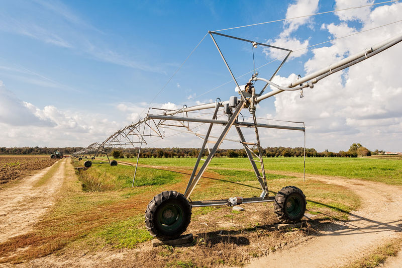 Irrigation Equipment On Field Against Sky