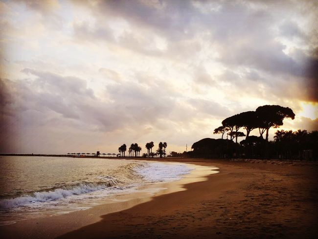 Cambrils Spaın Beach Water Sunset Silhouette Beauty In Nature Tranquility Sand Sea Travel Destinations Colours Sky Trees Outdoors Landscape EyeEmNewHere Scenery Holiday Destination Cloud - Sky Nature No People