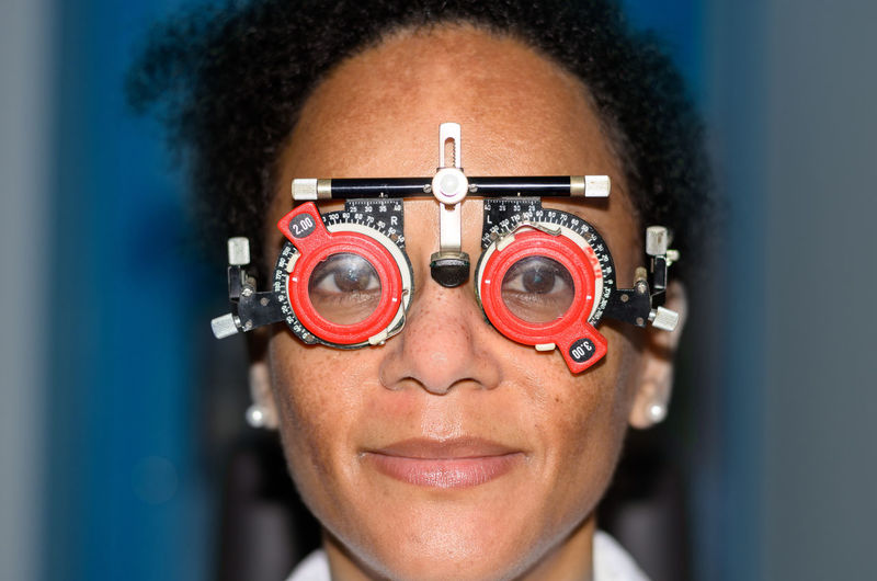 Close-Up Portrait Of Woman Wearing Eye Test Glasses
