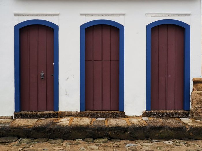 Doorways #2 Colourful Wood Travel Destinations South America Backpacking Travel Photography Brazil Cobblestone Brown Blue White Wall Architecture Colonial Architecture Doorway Door Entrance Architecture Close-up Building Exterior Sky Built Structure Front Door