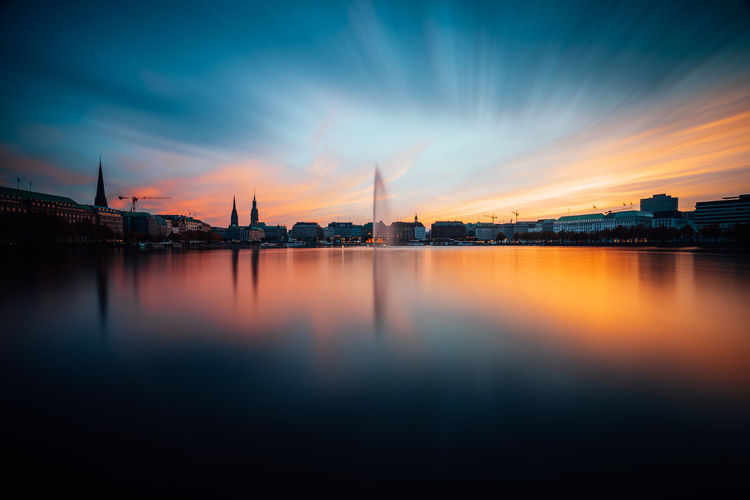 Panoramic view of Binnenalster, Inner Alster Lake in golden and blue evening light at sunset, Hamburg, Germany. Blue hour. Long exposure Sky Architecture Water Building Exterior Built Structure City Cloud - Sky Sunset Reflection Waterfront Nature Building Orange Color Travel Destinations Long Exposure Outdoors Cityscape Alster Hamburg Lake Sunset_collection Blue Hour Golden Hour Reflections In The Water City Shapes Fontaine