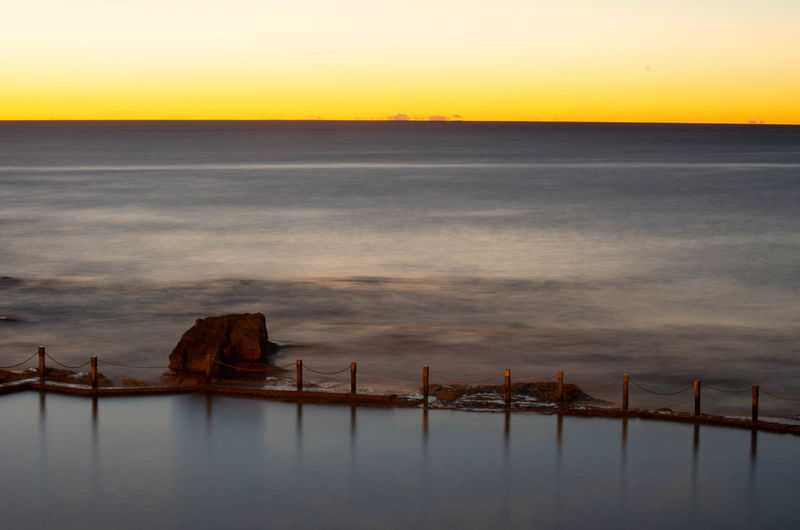 Bay Beauty In Nature Dusk Environment Fog Horizon Horizon Over Water Land Nature No People Outdoors Scenics - Nature Sea Sky Sunset Tranquil Scene Tranquility Transportation Urban Skyline Water