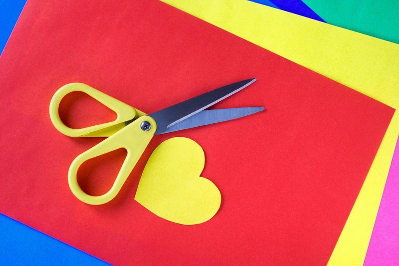 Scissors and colored paper School Supplies Heart Shape Cutting Origami Colored Paper Imagination Childhood Artist Creativity Creative colour of life Rainbow Colors Multi Colored Red Scissors Creativity Art And Craft Yellow Vibrant Color Craft Colored Background Design Shape Paper Table Directly Above Close-up