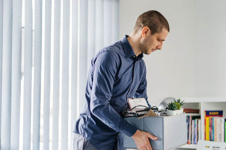 Man holding box in office