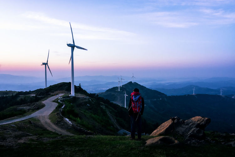 一起出发看日出 Alternative Energy Beauty In Nature Day Fuel And Power Generation Full Length Industrial Windmill Landscape Let's Go. Together. Lifestyles Mountain Nature One Person Outdoors People Real People Scenics Sky Standing Sunset Technology Wind Power Wind Turbine Windmill EyeEmNewHere An Eye For Travel