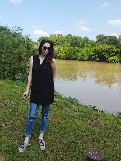 Only Women One Woman Only Adults Only One Person Adult Front View Full Length People Day Casual Clothing Standing Grass Sky Outdoors Tree One Young Woman Only Water Nature Young Adult