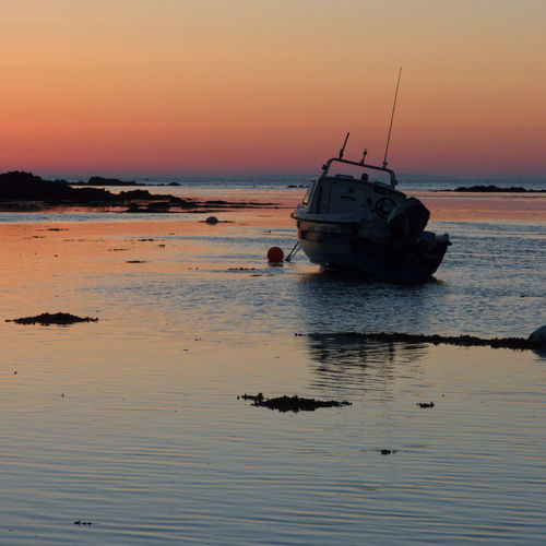A tranquil series of picture taken just as the sun starts to come up and the tide comes racing in at La Rocque, Jersey, Channel Islands Colourful Sky Dried Out Boat Incoming Tide Jersey Channel Island UK Just Before Sunrise La Rocque Moored Boat Shoreline Beach And Rocks Tranquil Scene Outdoors Live For The Story