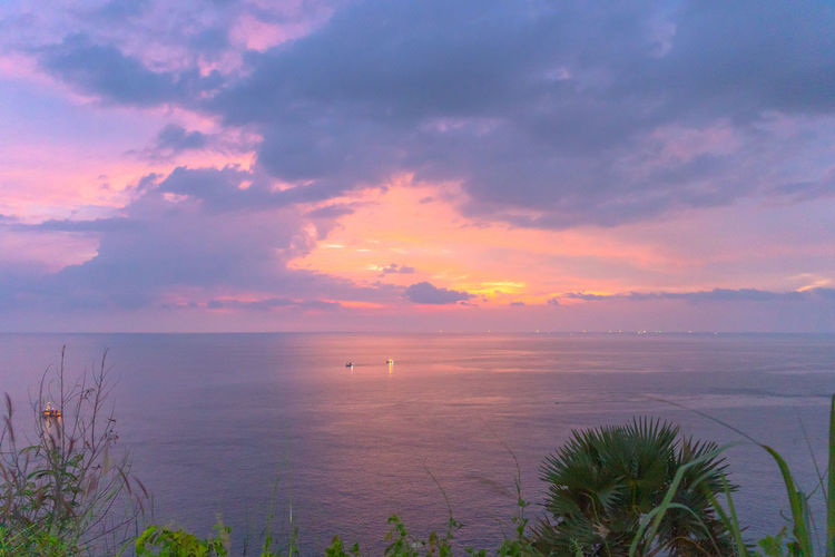 panorama sunset at Laem Promthep Cape. The landmark and popular viewpoint of Phuket Thailand. in every day a lot of tourists come here to watching sunset. Promthep Cape,phuket,landmark,travel, Promthep Phuket Landmark Viewpoint Famous Place Sunset, Sky Cloud - Sky Sweet Scenics - Nature Water Beauty In Nature Sea Tranquility Tranquil Scene Sunset Horizon Horizon Over Water Idyllic Plant Nature No People Non-urban Scene Outdoors Land Tree Bay Marram Grass
