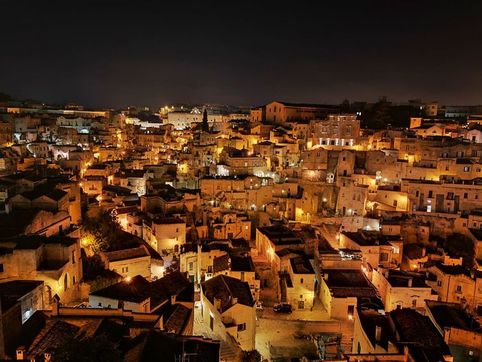 High angle shot of illuminated townscape against sky
