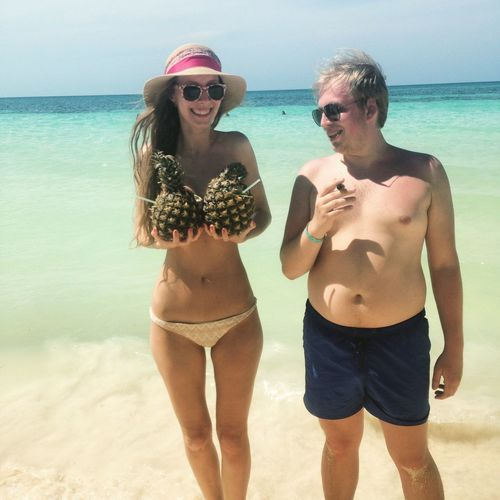 Enjoy The New Normal Sea Beach Water Two People Vacations Horizon Over Water Young Adult Real People Sunglasses Sand Standing Sky Beautiful Woman Front View Lifestyles Portrait Togetherness Relationship Piña Colada Pineapple Cuba Holiday Throwback
