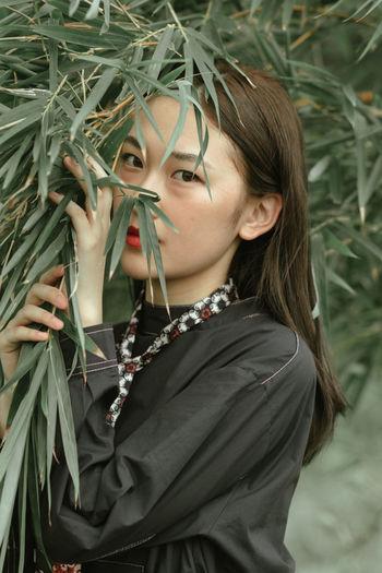 Portrait Of Woman By Plants