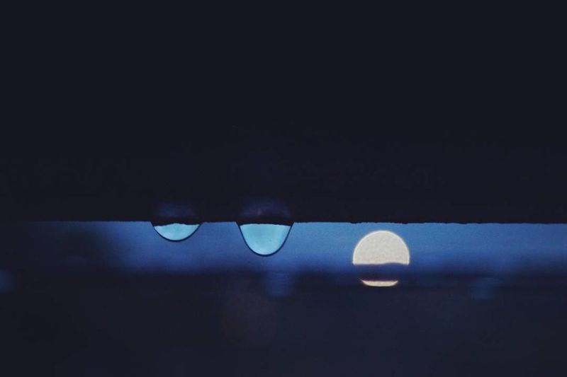 Close-up of water against sky at night