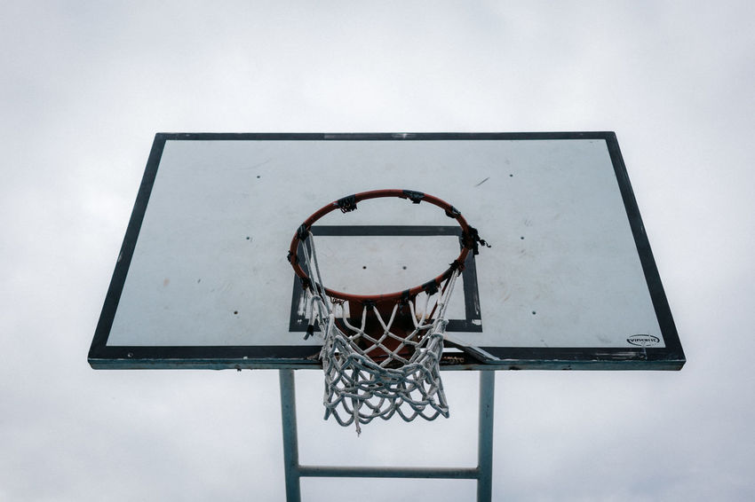 Basketball Basketball - Sport Basketball Hoop Basketball Player Close-up Court Day Leisure Games Low Angle View Making A Basket Net - Sports Equipment No People Outdoors Skill  Sky Sport Sports Equipment