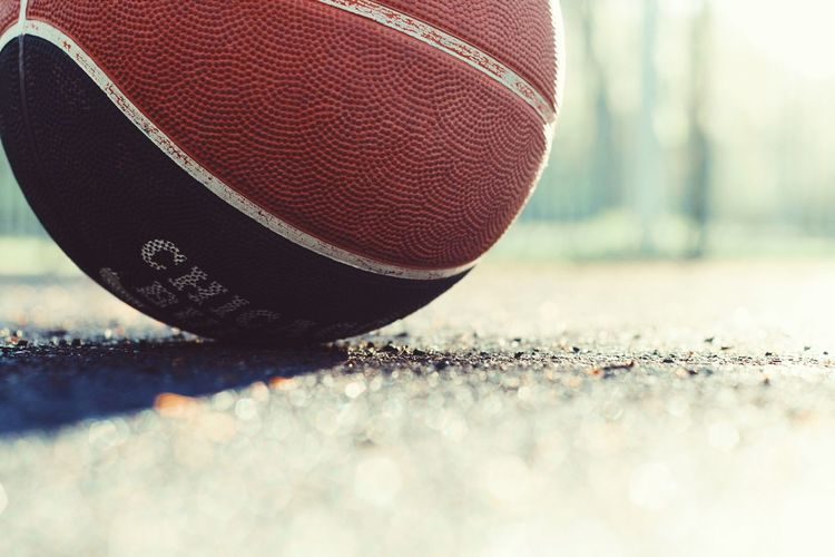 Basketball Ball Sport Day Close-up Selective Focus No People Competition Focus On Foreground Flooring American Football - Sport Motion Outdoors Basketball - Sport American Football - Ball Leisure Activity Sunlight Textured  Nature Surface Level