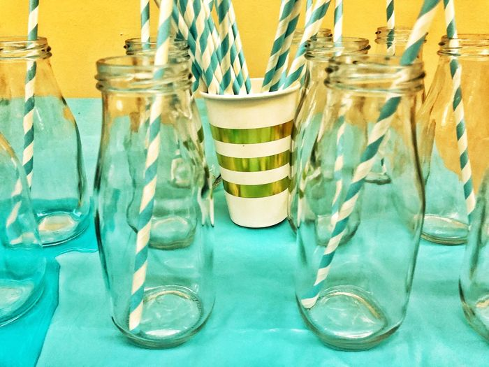 Still Life Paper Straws in Glass Bottles Empty Abstract No People Still Life Container Indoors  Jar Close-up Glass - Material Blue Glass Table Textile Art And Craft Transparent Striped Drinking Glass Household Equipment Bottle Choice Creativity
