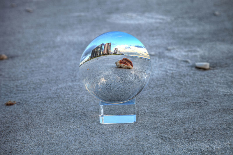 Reflection of crystal ball on glass