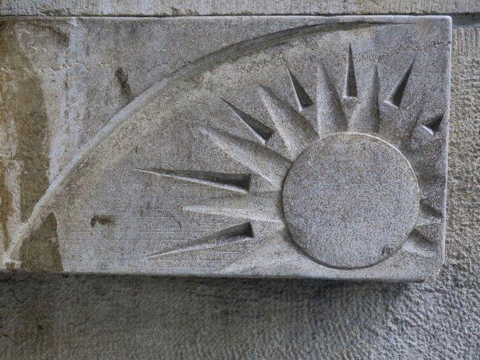 image of the sun in freestone Close-up No People Wall - Building Feature Geometric Shape Outdoors Sun Shape Pattern Wall Architecture Symbol Freestone Built Structure Carving - Craft Product Old Decoration Ornament Ornate Grey Stone