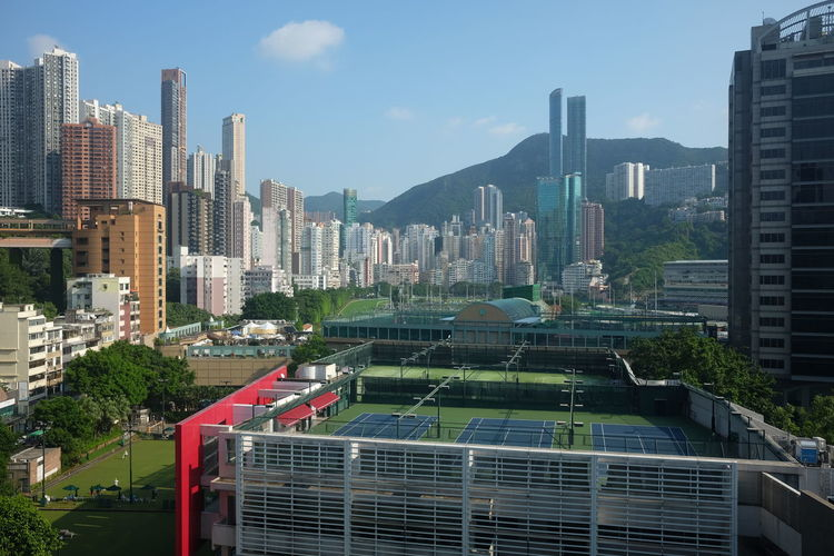 Hong Kong Architecture Building Exterior Built Structure Causewaybay  City Cityscape Day Growth Happyvalley Modern Nature No People Outdoors Sky Skyscraper Sunny Day Tenniscourt Tree
