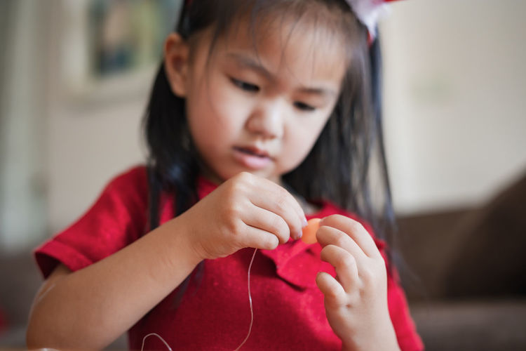 Close-up of cute girl making decoration