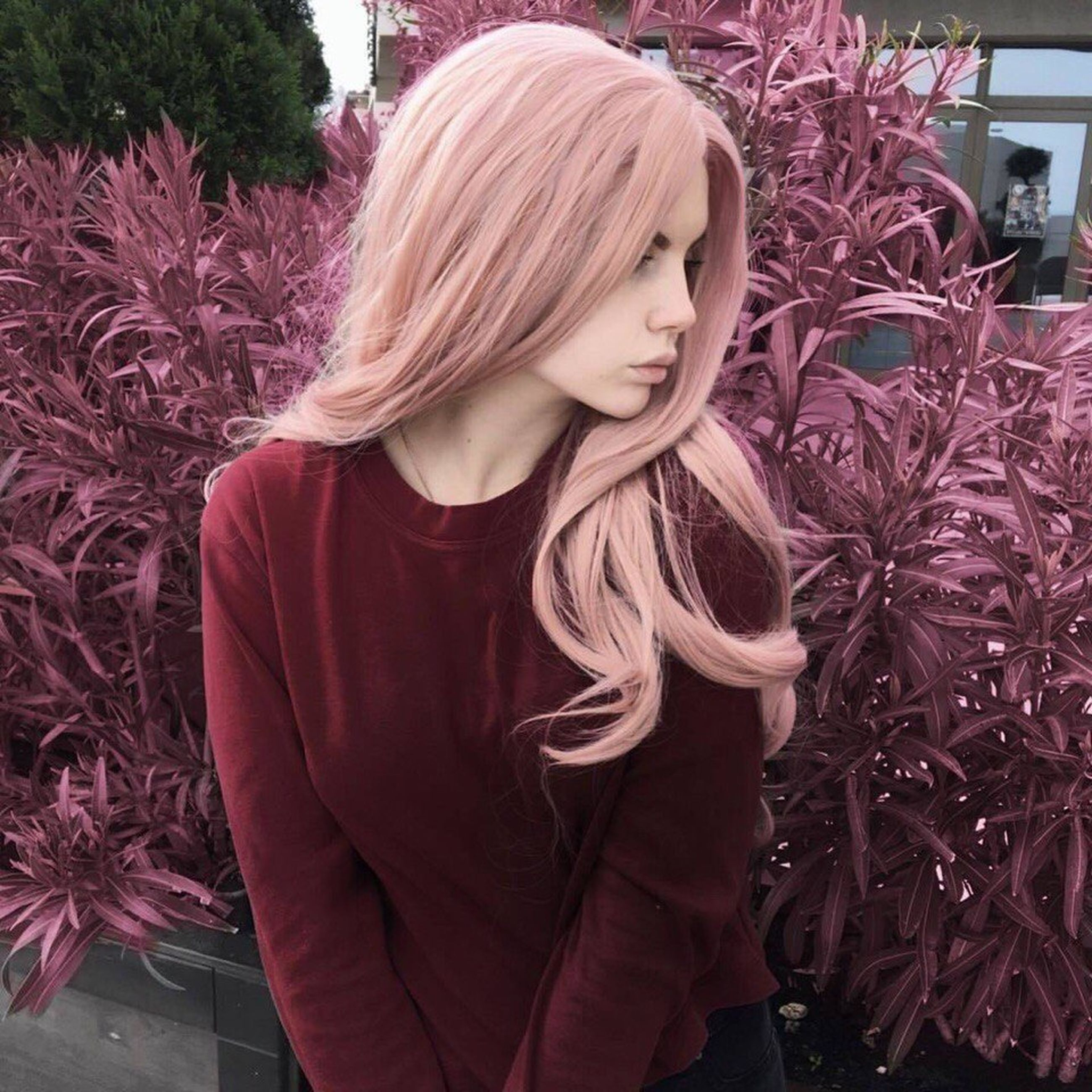 one person, standing, young adult, long hair, front view, real people, young women, flower, lifestyles, blond hair, beautiful woman, outdoors, day, people