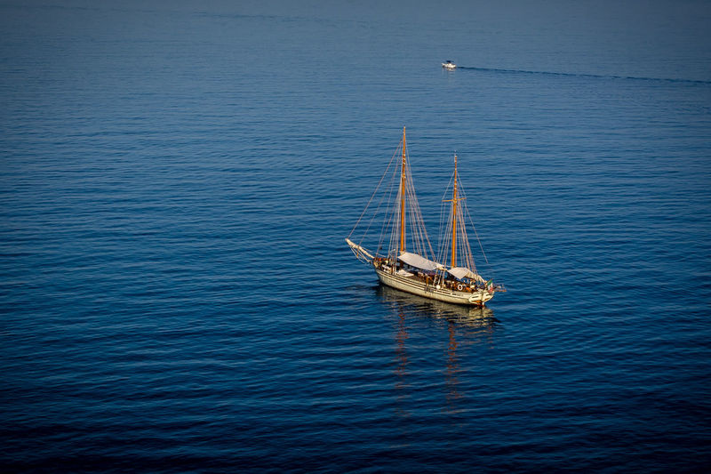 Beauty In Nature Blue Boat Day High Angle View Italy Journey Nature Nautical Vessel No People Non-urban Scene Outdoors Sailing Sailing Boat Scenics Sea Seascape Sorrento Tourism Tranquil Scene Tranquility Transportation Water Waterfront