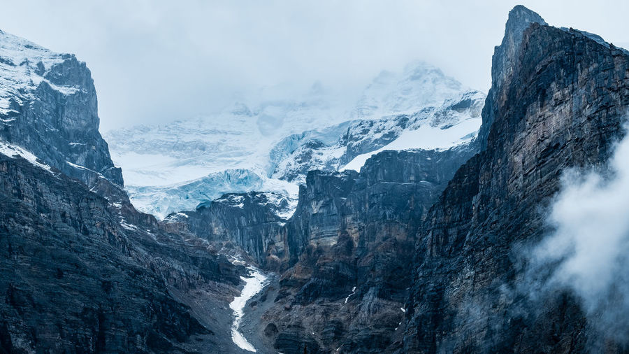 Glacier Saddle upon surrounding mountains, magnificent mountain scenery! Moraine Lake, Banff National Park, Alberta, Canada. Nature Landscape Ice Winter Snow Outdoors Rock Tranquility Mountain Glacier Environment Nature_collection Mountain Peak Beauty In Nature Solid No People Formation Landscape_Collection Tranquil Scene Mountain Range Non-urban Scene Rock - Object Cold Temperature Snowcapped Mountain Scenics - Nature Sky Day Idyllic Stay Out