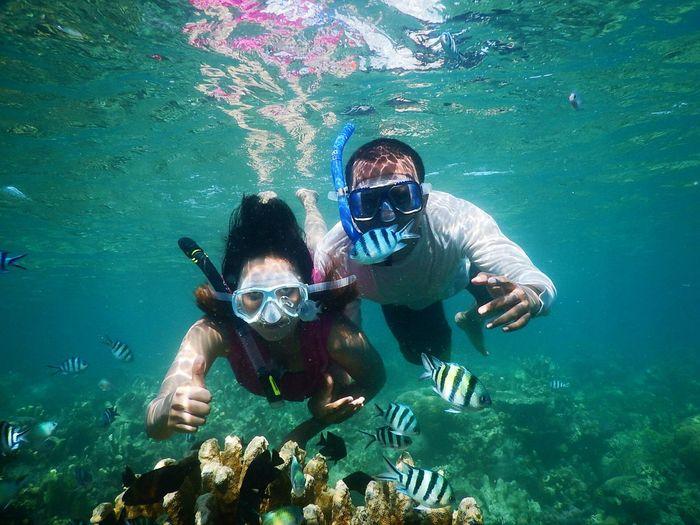 Couple snorkeling in sea