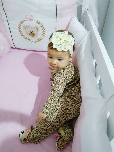 High Angle View Of Baby Girl In Crib At Home