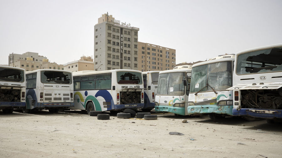 Mahboulah, Kuwait - April 2018 My Best Photo Deterioration Mahboula Kuwait Derelict Building Exterior Architecture City Sky Land Vehicle Public Transportation Building Nature Clear Sky No People Office Building Exterior Rail Transportation Train Outdoors Motor Vehicle Travel Skyscraper The Photojournalist - 2019 EyeEm Awards