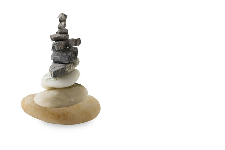 Close-up of stone stack against white background