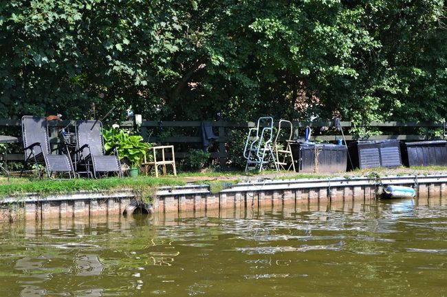 Reclining garden chairs, folding chairs of various styles on the side of the towpath of the Lancaster Canal Canal Towpath Homely Relaxing Towpath Photography Architecture Built Structure Day Growth Lake Lancaster Canal Motion Nature No People Outdoors Park Park - Man Made Space Plant Reflection Seating Swimming Pool Tranquility Tree Water Waterfront