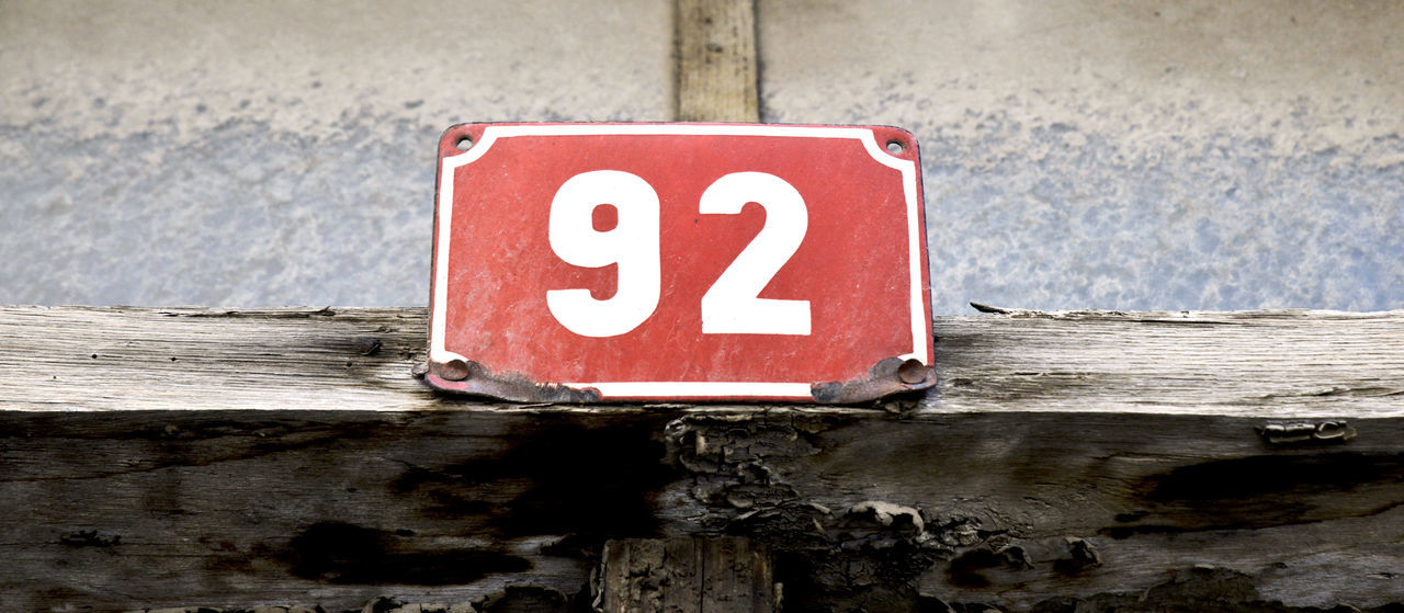 2 9 92 Wood Built Structure Close-up Day Door Number Dust Nine No People Number Plate Old Outdoors Plate Red Red Nails Street Number Two Water