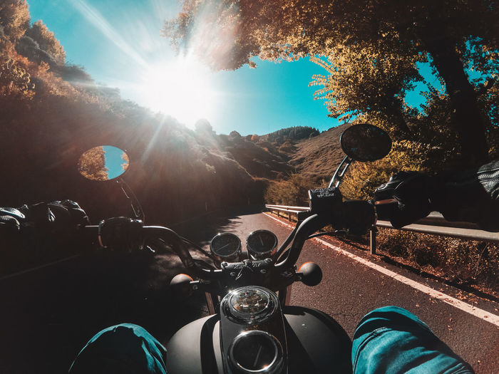 People riding motorcycle on sunny day