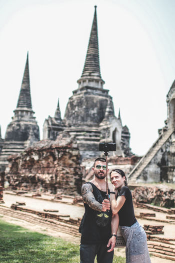 Couple tourism selfie in front of old retro historical period theme outdoor at Ayuthaya on 27 May 2019 Architecture Built Structure Two People History Place Of Worship Building Exterior The Past Travel Destinations Religion Real People Togetherness Ancient Travel Tourism Building Sky People Belief Young Adult Couple - Relationship Outdoors Old Ayutthaya ASIA Buddhism Culture Thailand Tourist Ayuthaya Selfie Ancient Travel Temple Architecture Traditional Woman Buddha Historical Landmark Heritage Vacations Discover Your City Religious  Worship Traveler Historical Park Backpack Holidays Historic Civilization
