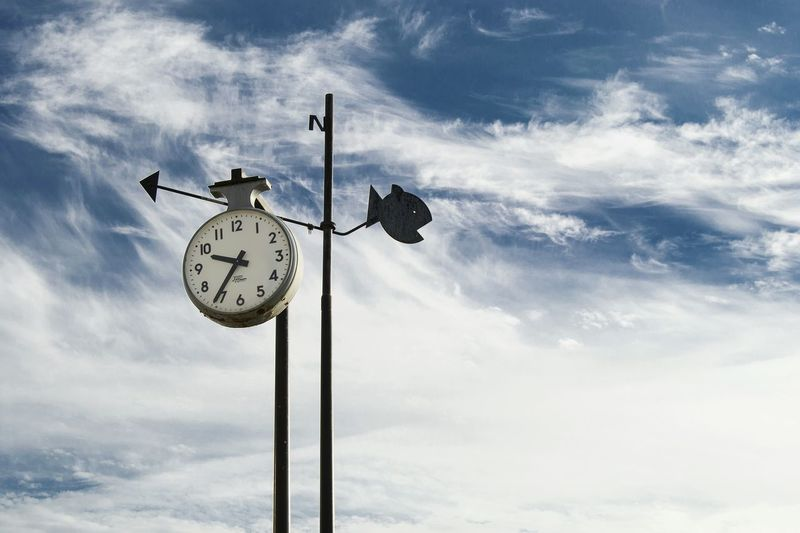 Guidance Direction Cloud - Sky Minute Hand Clock Time Sky El Campello The Time The Times Watch The Clock Compass Cardinal Points North North Sea Directional Sign Sign EyeEm Best Shots Blue Sky No People Day Clouds Collection Fish Port