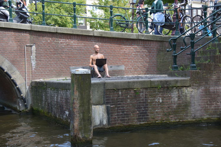 Check This Out Dude Creating His Own Space Amsterdam Canal Streetphotography Peoplephotography Discover Your City