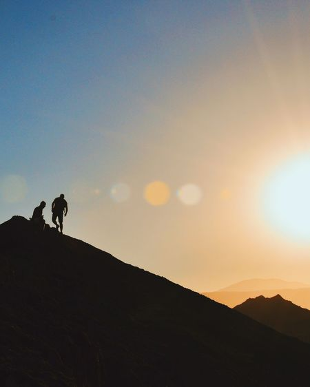 SILHOUETTE OF PEOPLE STANDING ON LANDSCAPE