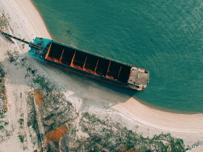 Aerial view of ship at shore