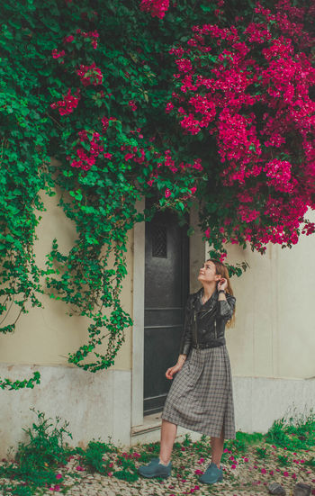 Plant One Person Flower Growth Real People Flowering Plant Nature Full Length Standing Built Structure Lifestyles Architecture Entrance Building Exterior Day Young Adult Leisure Activity Dress Beauty In Nature Outdoors