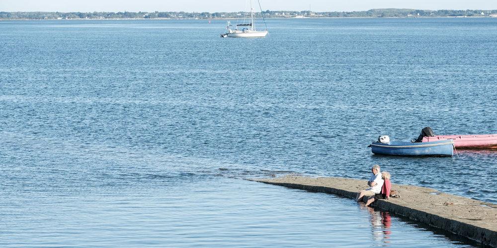 Scenic view of sailboat in sea