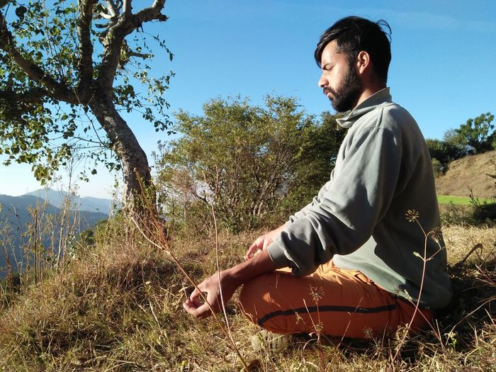 Yoga in peaceful environment on hills in uttarakhand, chakrata Yoga Pose Yoga ॐ Yoga Practice Yoga Meditation Meditation On Hills Yoga In Peaceful Environment Of Uttarakhand Chakrata EyeEm Selects One Person Plant Leisure Activity Tree Nature Sky Lifestyles Young Men Land Side View Outdoors Sunlight Young Adult Grass Casual Clothing Real People Men Full Length The Modern Professional EyeEmNewHere Holiday Moments
