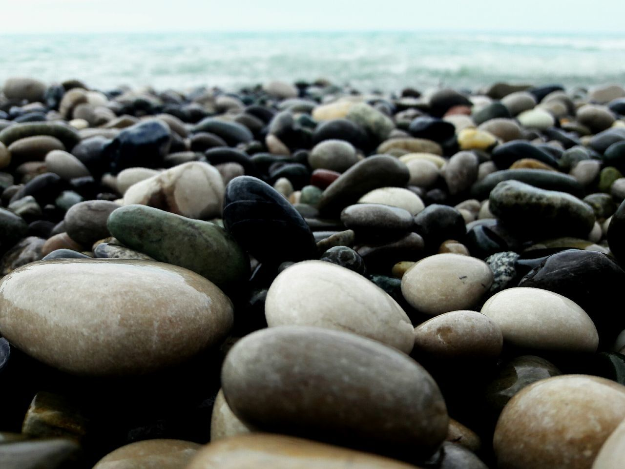View Of Pebbles At Beach