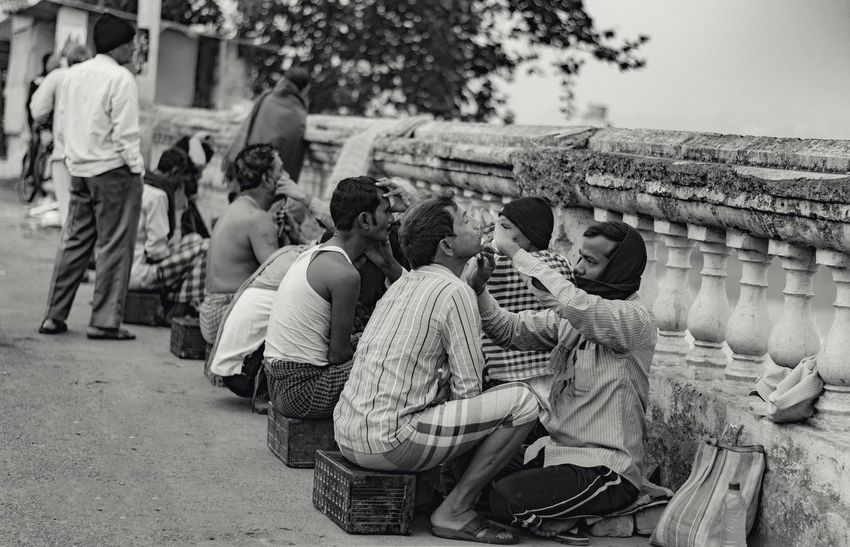 Black And White Photography Blackandwhite Built Structure Calcutta Calcuttadiaries Calcuttastreets Day EyeEm Best Shots EyeEm Gallery EyeEmNewHere Ghats On The Ganges Kolkatadiaries Large Group Of People Men Morning Rituals Outdoors Real People Saloon Time Shaving Sitting Streetart Streetphotography